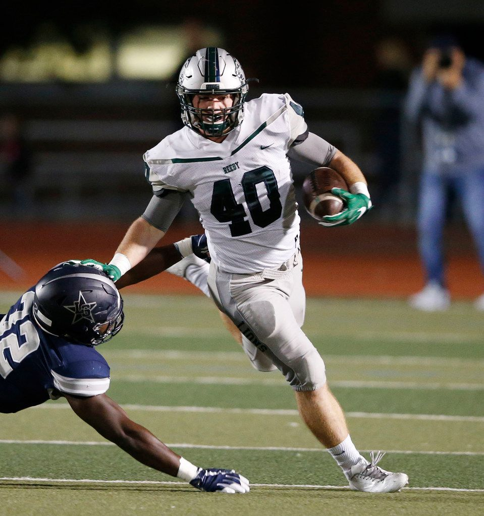 Frisco Reedy's Will Harbour (40) stiff arms Frisco Lone Star's Nicholas Bolton (32) on a run play during the first half of play at FISD Memorial Stadium in Frisco, Texas on Friday, November 3, 2017. (Vernon Bryant/The Dallas Morning News)