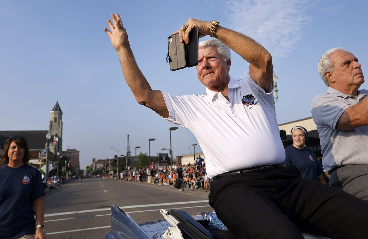 Dallas Cowboys head coach and Pro Football Hall of Fame inductee Jimmy Johnson shoots a video of his experience as he rides in the Canton Repository Grand Parade in downtown Canton, Ohio, Saturday, August 7, 2021. The parade honored newly elected and former members of the Hall, including newcomers and former Dallas Cowboys players Cliff Harris, Drew Pearson and head coach Jimmy Johnson. (Tom Fox/The Dallas Morning News)