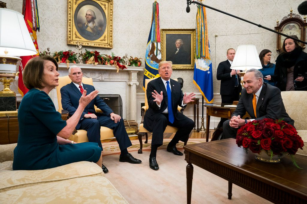 President Donald Trump and Vice President Mike Pence meet with House Minority Leader Nancy Pelosi, D-Calif., and Senate Minority Leader Chuck Schumer, D-N.Y., at the White House in Washington on Dec. 11, 2018.