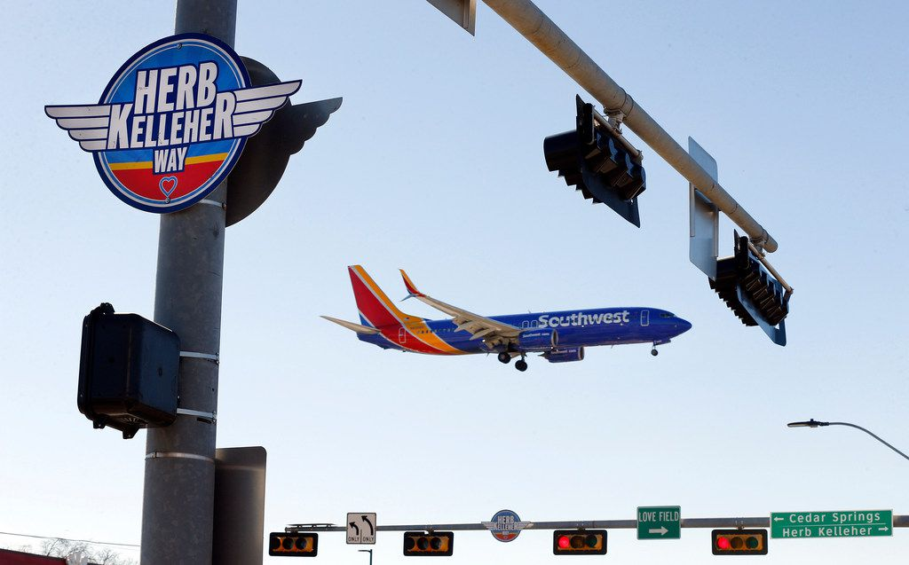 Southwest Airlines Flight 1433 from Oakland passed a Herb Kelleher Way sign as it landed at Dallas Love Field on Jan. 4, 2019.