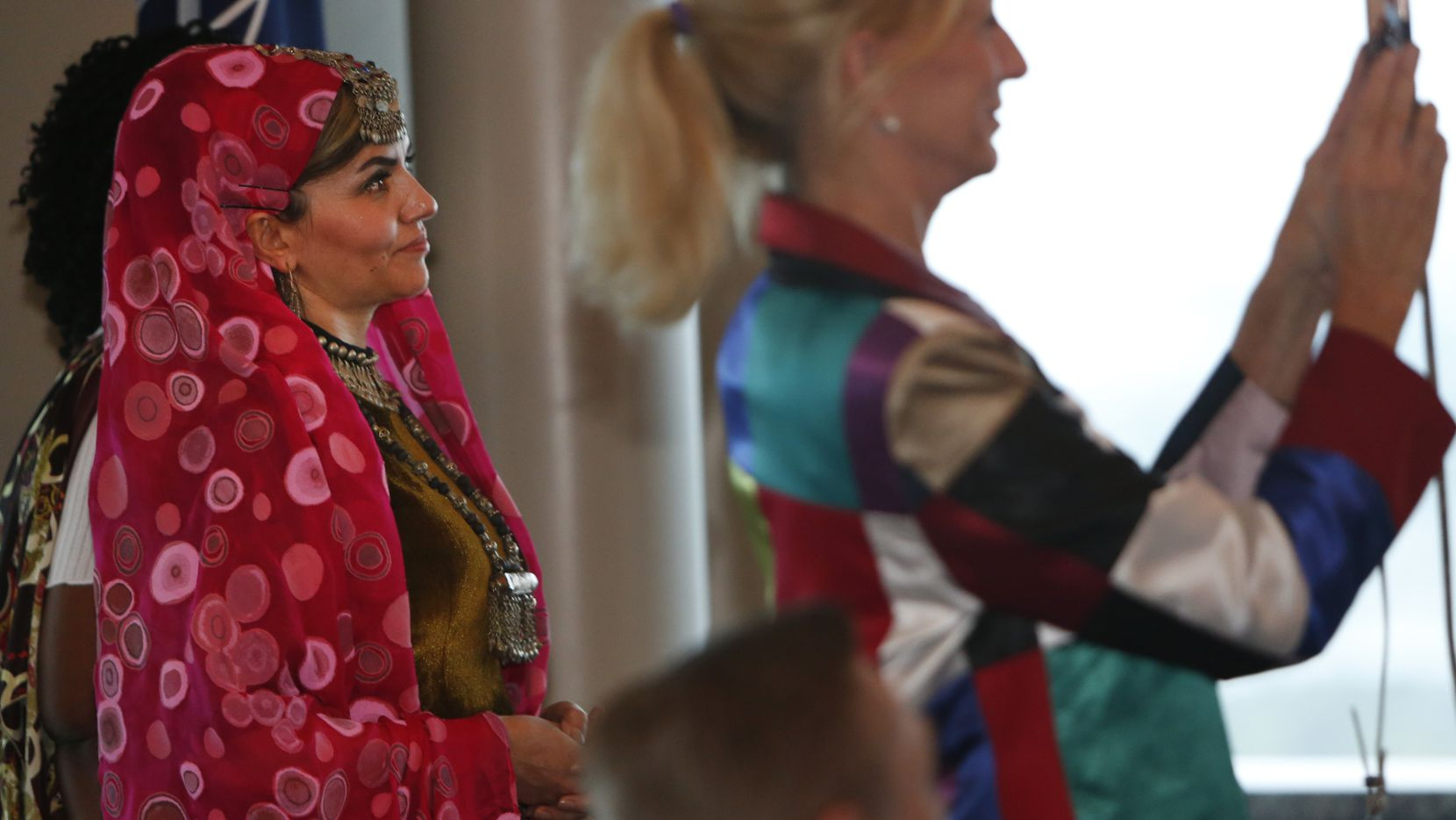 Mohsina Sageb (left), president and designer of Jama Sageb handicraft company in Afghanistan, watched a fellow graduate cross the stage at graduation ceremonies for attendees of the Peace Through Business entrepreneurial boot camp in Irving in 2018.