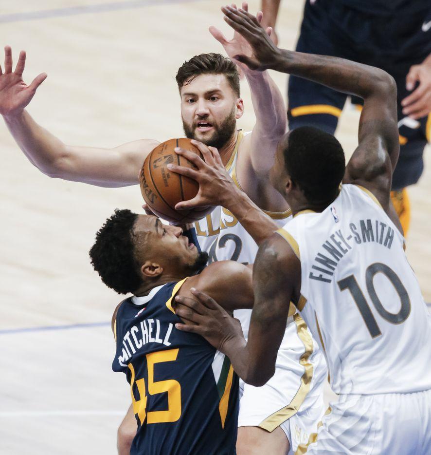 Utah Jazz guard Donovan Mitchell (45) attempts a shot as Dallas Mavericks forwards Maxi Kleber (42) and Dorian Finney-Smith (10) defend during the first half of an NBA basketball game in Dallas, Monday, April 5, 2021. (Brandon Wade/Special Contributor)
