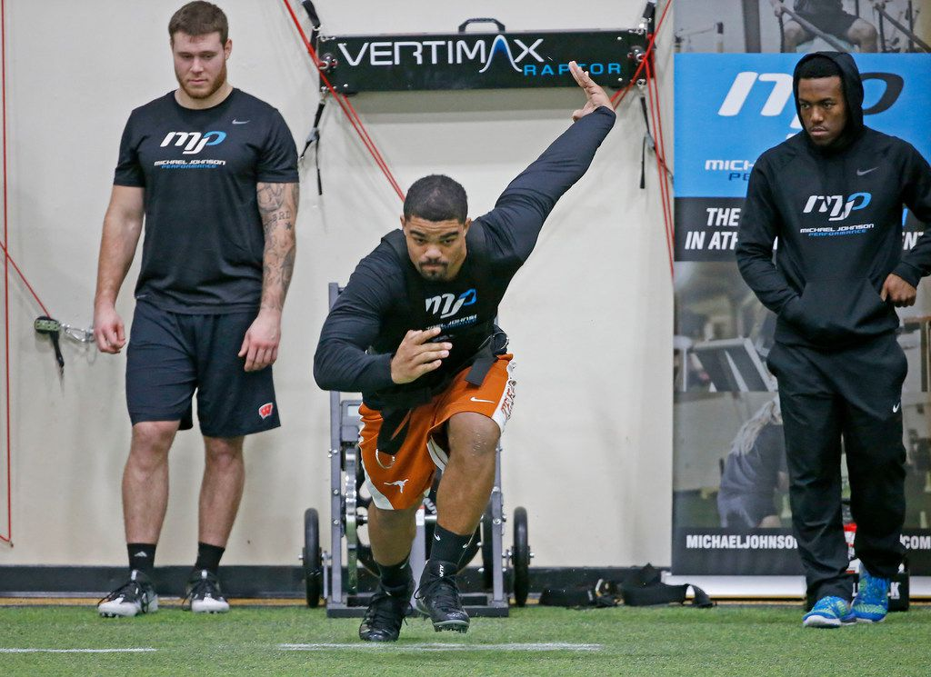 Chris Warren III, center, works out during an annual media day at Michael Johnson Performance in McKinney, Texas, Wednesday, Feb. 14, 2018. (Jae S. Lee/The Dallas Morning News)