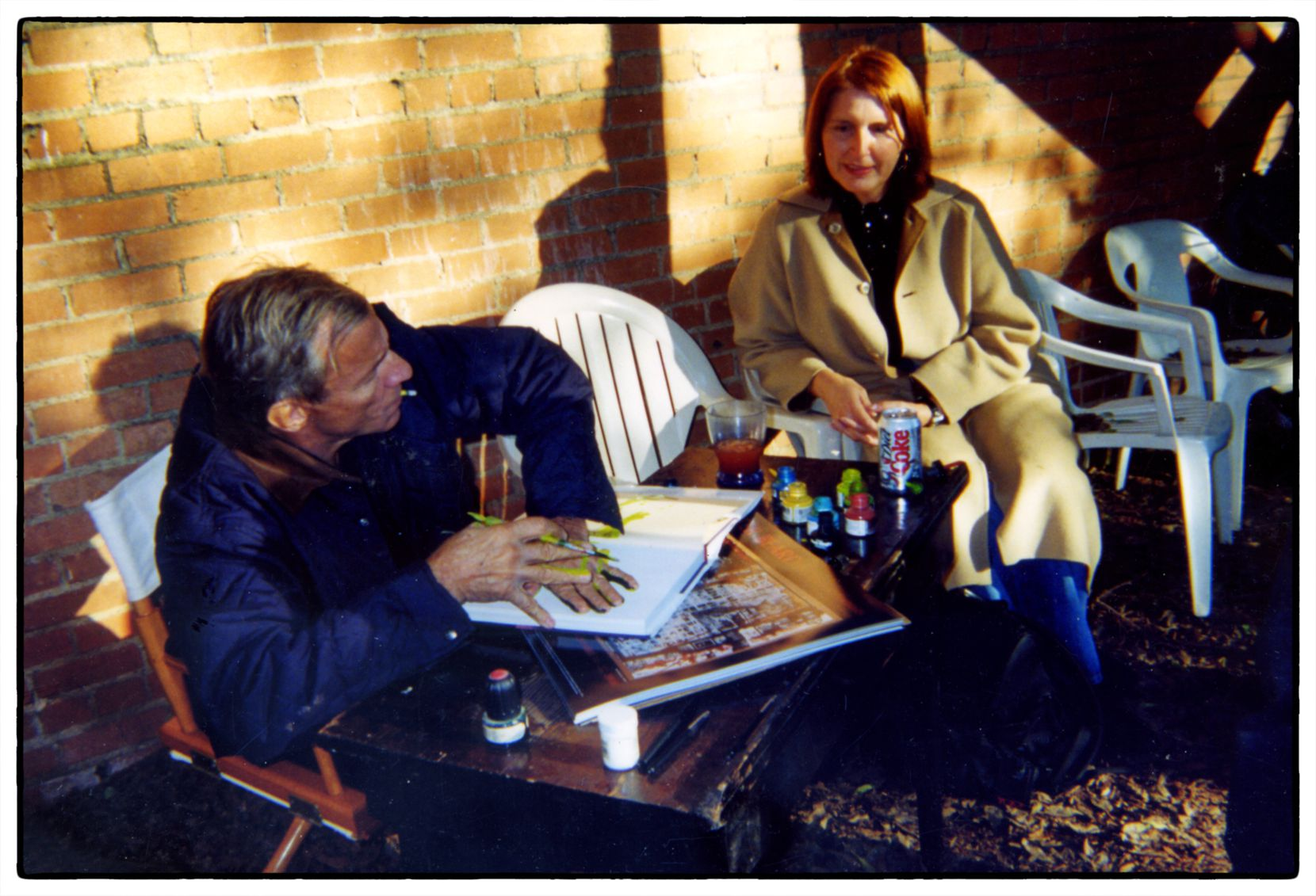 Karen Blessen talks with Peter Beard during the exhibit of his works at the Boyd Gallery in Dallas in 2000.