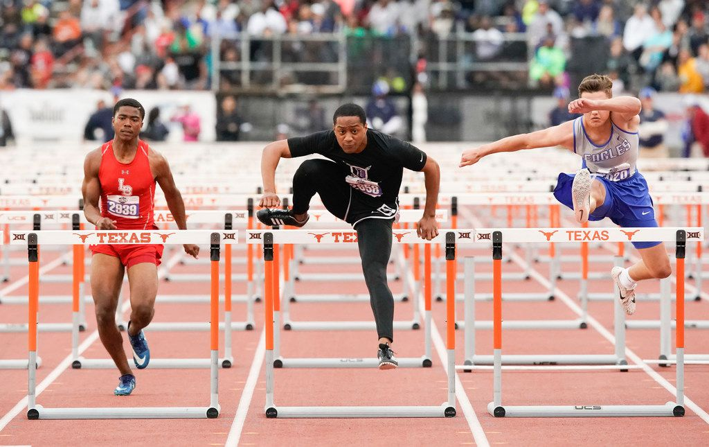 Terry Smith of Frisco Independence (center) clears the final hurdle to win the Class 5A boys 110-meter hurdles at the UIL State Championships in Austin. At left is Tru Edwards of Mansfield Legacy.  (Bob Daemmrich/Special Contributor)