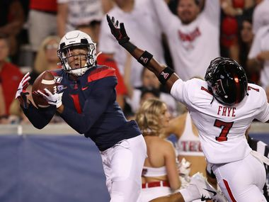 TUCSON, ARIZONA - SEPTEMBER 14:  Wide receiver Drew Dixon #1 of the Arizona Wildcats attempts to catch an incomplete pass ahead of defensive back Adrian Frye #7 of the Texas Tech Red Raiders during the first half of the NCAAF game at Arizona Stadium on September 14, 2019 in Tucson, Arizona.