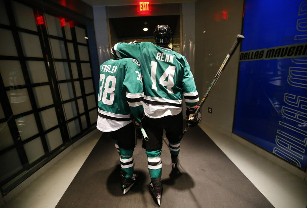 The Stars' Jamie Benn embraced teammate Vernon Fiddler  as they headed for the locker room after Wednesday night's Game 7 loss to the St. Louis Blues at American Airlines Center.