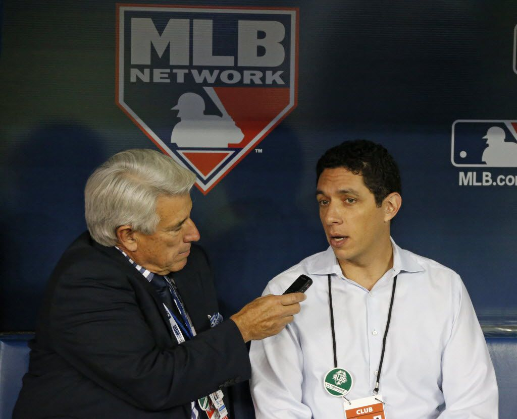 Texas general manager Jon Daniels, right, is interviewed by announcer Buck Martinez during batting practice before  Game 1 of the ALDS between the Texas Rangers and the Toronto Blue Jays  at Rogers Centre in Toronto, Canada on Wednesday, October 7, 2015. (Louis DeLuca/The Dallas Morning News)