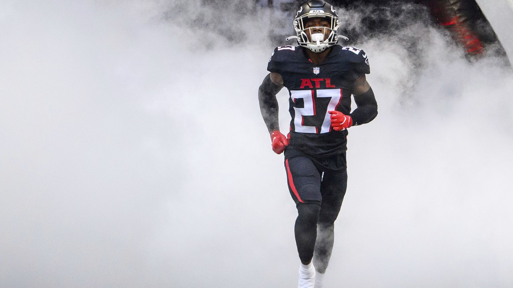 Atlanta Falcons strong safety Damontae Kazee (27) runs out of the tunnel before an NFL football game against the Chicago Bears, Sunday, Sept. 27, 2020, in Atlanta. The Chicago Bears won 30-26.