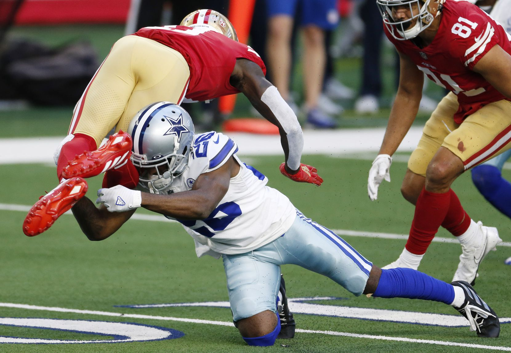 FILE - Cowboys cornerback Jourdan Lewis (26) tackles 49ers wide receiver Brandon Aiyuk (11) for a loss during the second quarter of a game on Sunday, Dec. 20, 2020, at AT&T Stadium in Arlington.
