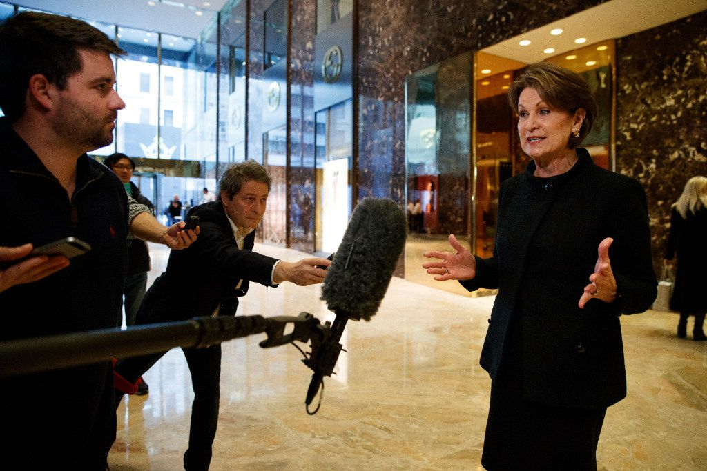 Lockheed Martin CEO Marillyn Hewson talks to reporters in the lobby of Trump Tower in New York on Friday, after a meeting with President-elect Donald Trump. (AP Photo/Evan Vucci)