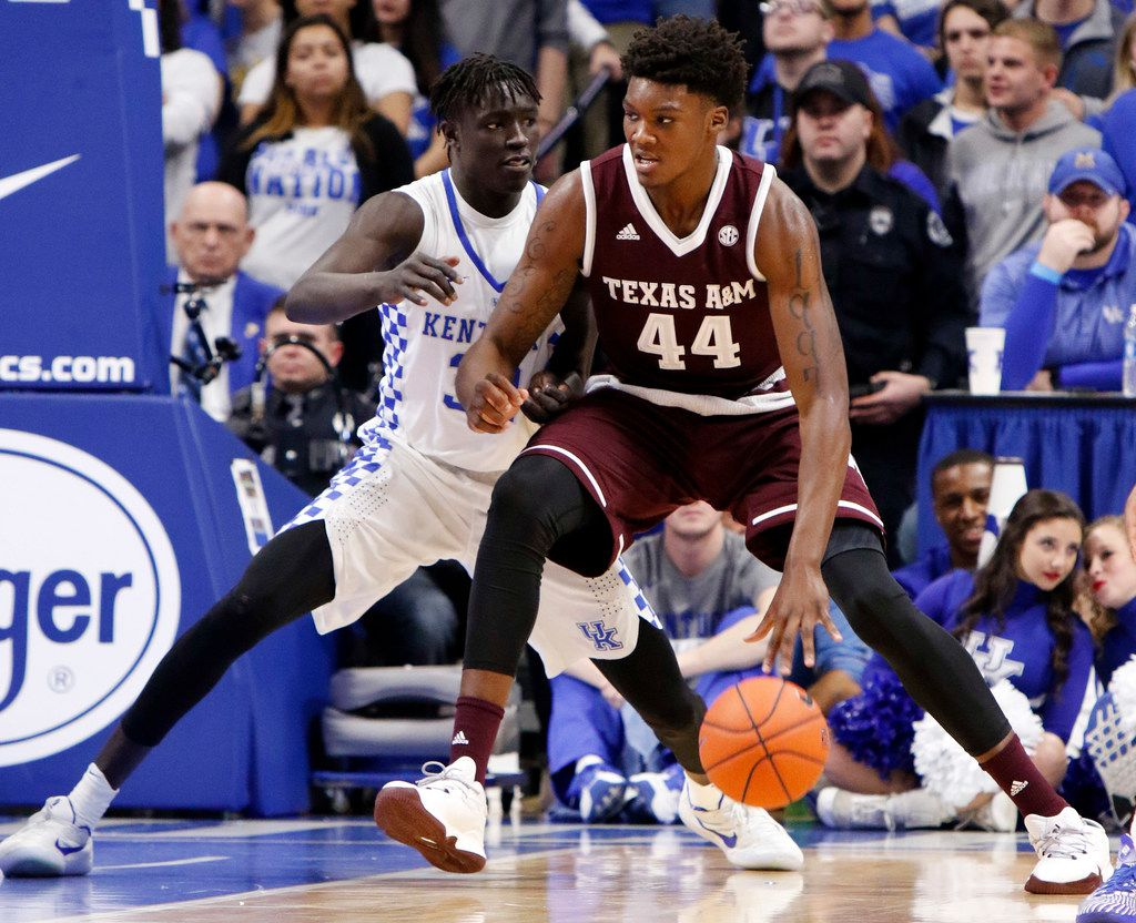FILE - In this Tuesday, Jan. 3, 2017 file photo, Texas A&M's Robert Williams (44) drives while defended by Kentucky's Wenyen Gabriel during the first half of an NCAA college basketball game in Lexington, Ky. Coming off a tough season, the Texas A&M Aggies got a huge boost when projected NBA lottery pick Robert Williams chose to forego the draft to return to the team. The Aggies have made the NCAA tournament just once since coach Billy Kennedy took over for the 2011-12 season, but believe they have a good chance of returning this season with this talented team. (AP Photo/James Crisp, File)