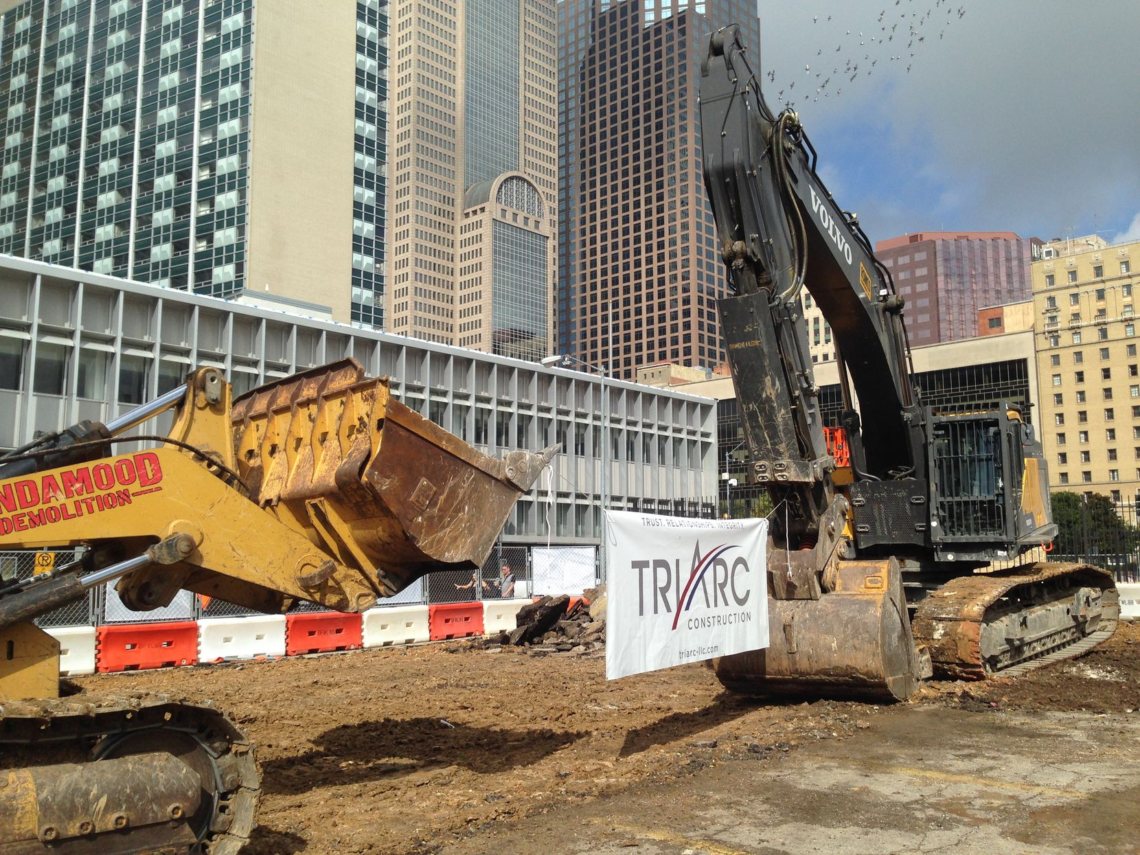 Construction has started on a garage, retail and residential building next to the Statler project on Harwood Street.