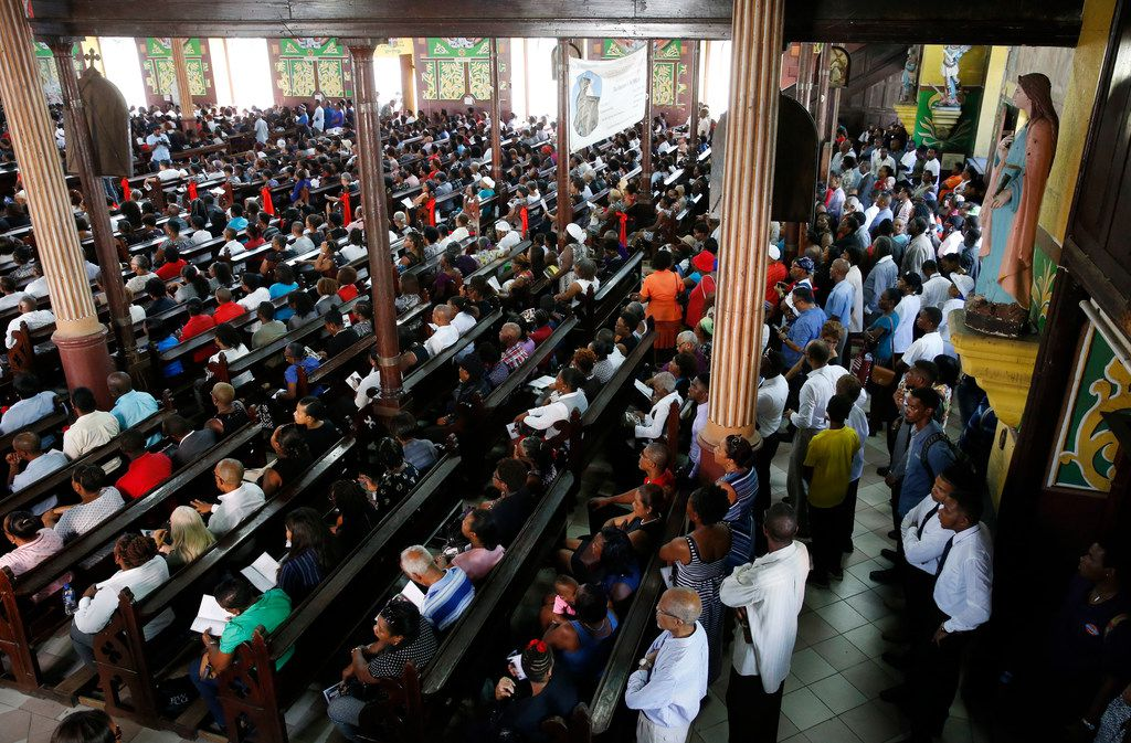 People stand in the back of the church during the funeral of Botham Shem Jean at Minor Basilica of the Immaculate Conception in Castries, St. Lucia on Monday, September 24, 2018. Jean was shot and killed in his apartment by off duty Dallas police officer Amber Guyger. (Vernon Bryant/The Dallas Morning News)