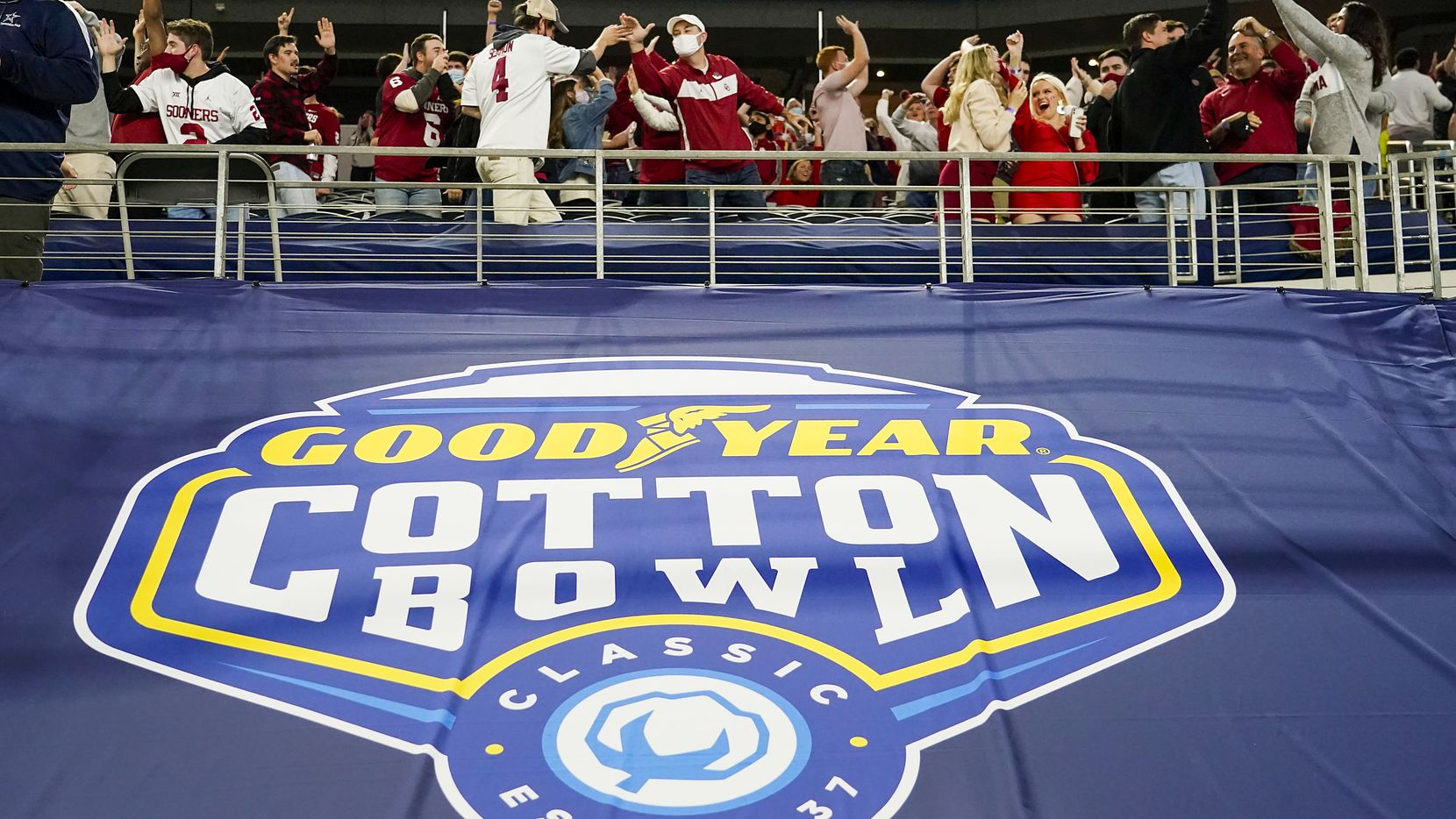 Oklahoma fans celebrate a Sooners touchdown during the first half of the Cotton Bowl Classic against Florida at AT&T Stadium on Wednesday, Dec. 30, 2020, in Arlington.