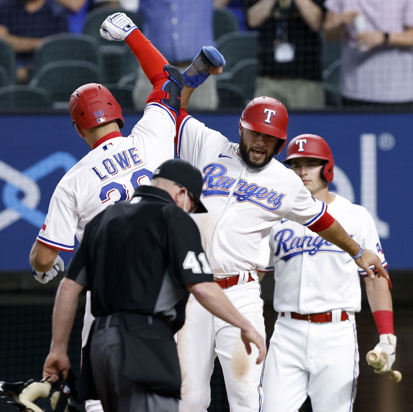 Texas Rangers Nate Lowe (30) is congratulated by teammate Isiah Kiner-Falefa (9) after driving him on a two-rbi home run during first inning against the Toronto Blue Jays at Globe Life Field in Arlington, Tuesday, April 7, 2021. (Tom Fox/The Dallas Morning News)