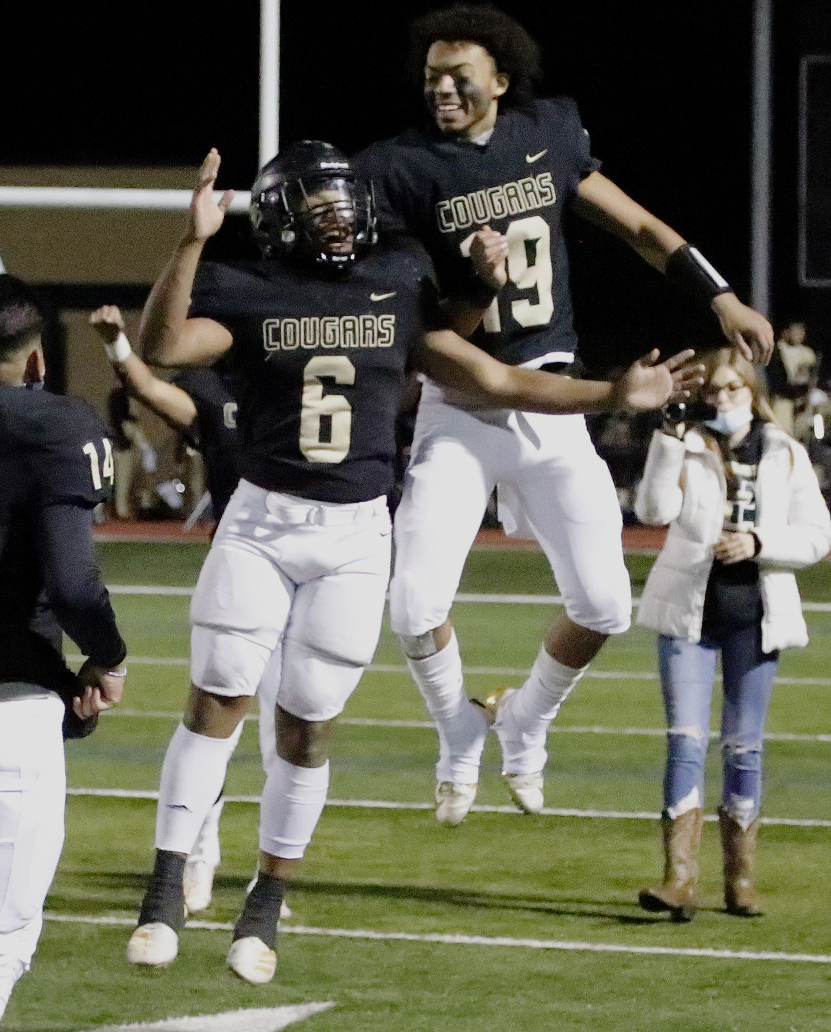 The Colony High School running back Kamden Wesley (6) and The Colony High School quarterback Jonathan Roberson (19) leap to celebrate their victory after the game as The Colony High School hosted Frisco Reedy High School at Tommy Briggs Stadium on Friday night, December 4, 2020.  (Stewart F. House/Special Contributor)