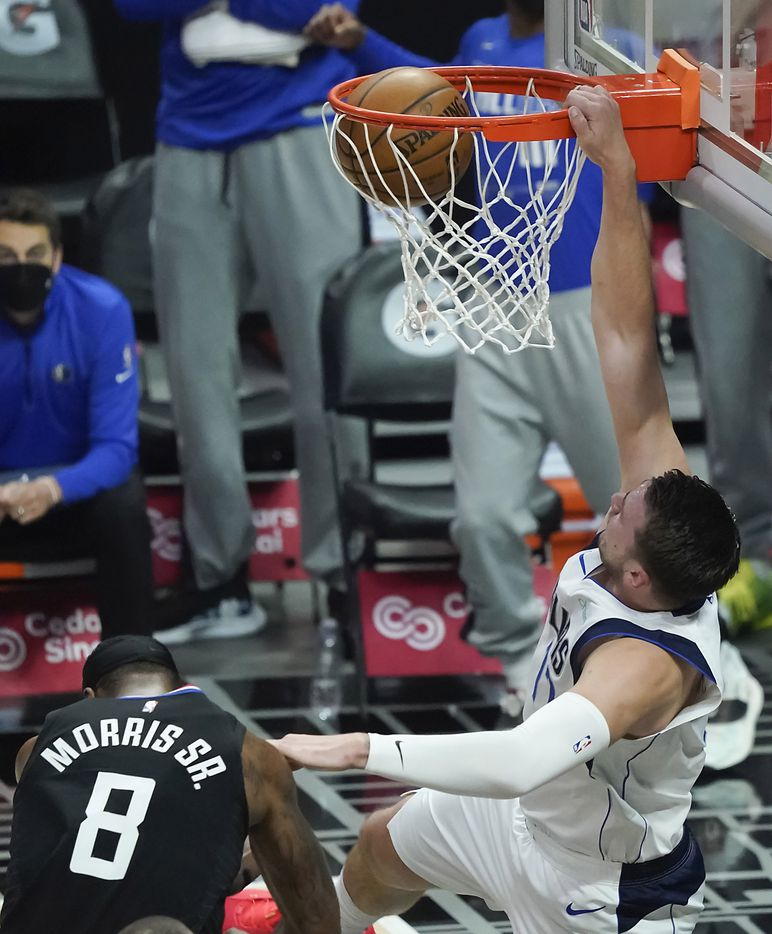 Dallas Mavericks guard Luka Doncic (77) dunks the ball past LA Clippers forward Marcus Morris Sr. (8) during the first half of an NBA playoff basketball game at Staples Center on Tuesday, May 25, 2021, in Los Angeles.