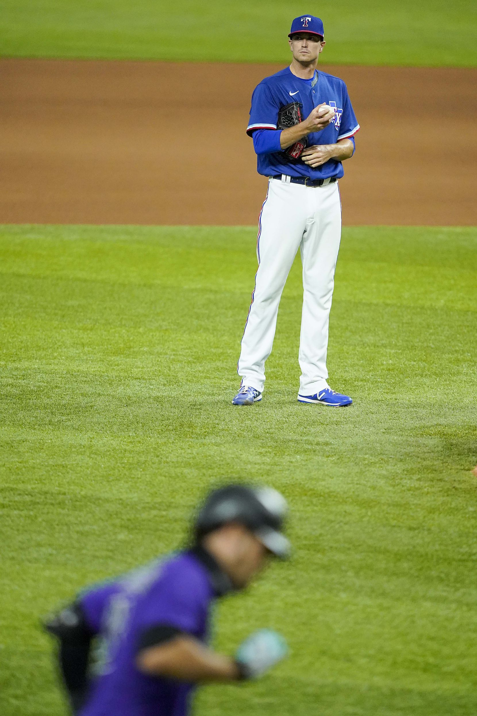 Texas Rangers pitcher Kyle Gibson watches Colorado Rockies third baseman Nolan Arenado round the bases after hitting a 2-run home run during the fourth inning of an exhibition game at Globe Life Field on Tuesday, July 21, 2020.