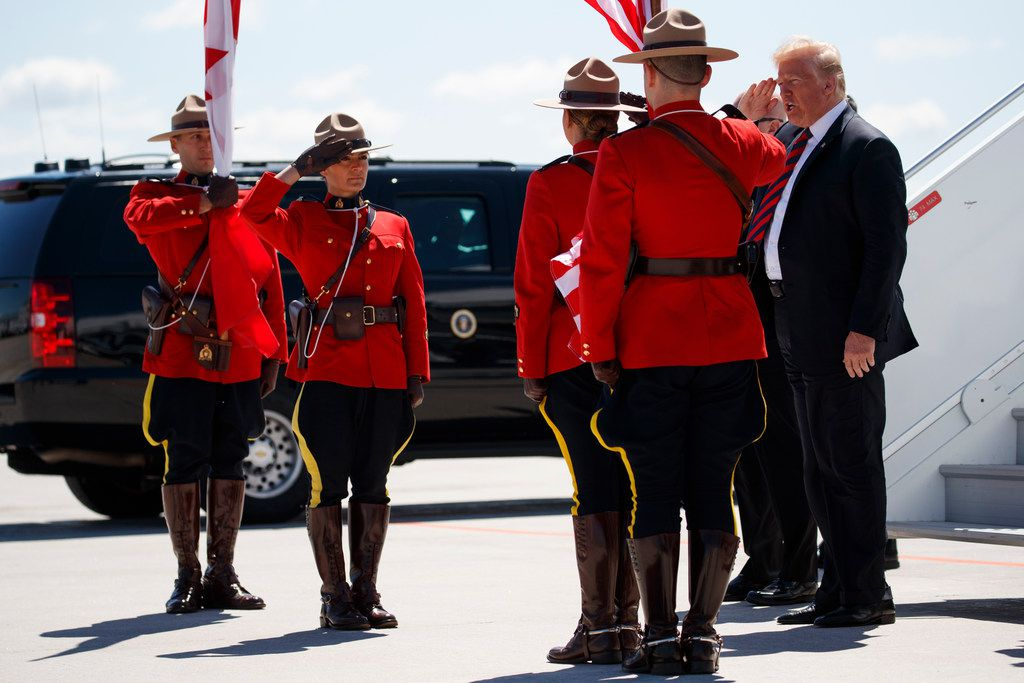President Donald Trump salutes after stepping off Air Force One as he arrives for the G7 Summit, Friday, June 8, 2018, in Canadian Forces Base Bagotville, Canada. (AP Photo/Evan Vucci)