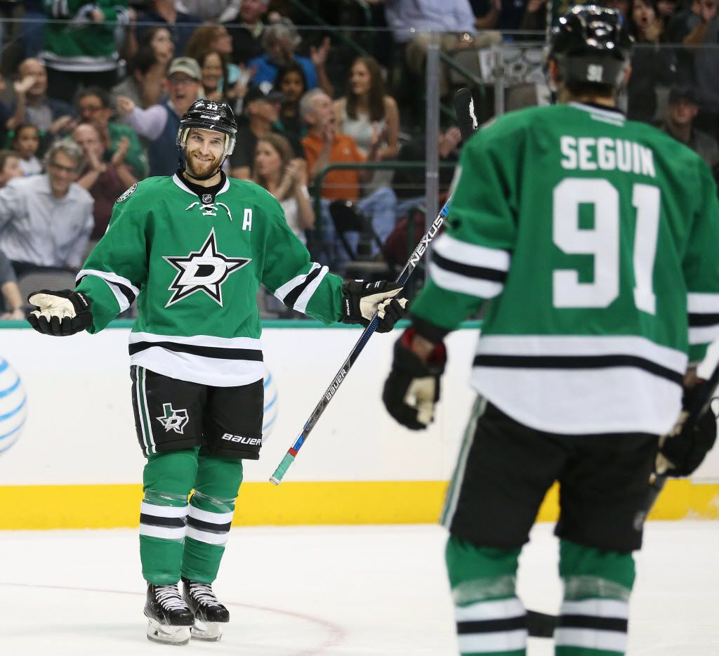 Dallas Stars center Tyler Seguin (91) approaches defenseman Alex Goligoski (33) after Goligoski scored a goal in the first period during a National Hockey League game between the Los Angeles Kings and the Dallas Stars at the American Airlines Center in Dallas Tuesday March 15, 2016. Goligoski is one of four Stars defensemen who can become  a free agent on July 1. (Andy Jacobsohn/The Dallas Morning News)