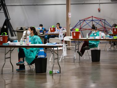 Staff waits to deliver COVID-19 vaccines at Fair Park in Dallas on Wednesday, Feb. 2, 2021.