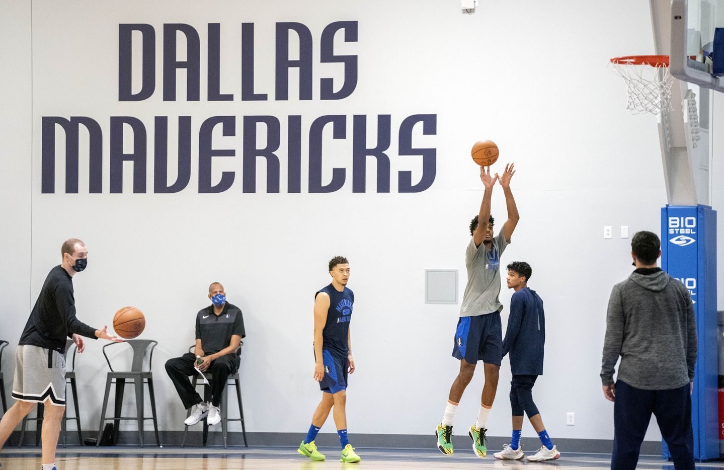 Dallas Mavericks forward Feron Hunt takes a shot as JaQuori McLaughlin, left, and Tyrell Terry, right, look on during the first practice of training camp Tuesday, September 28, 2021 at the Dallas Mavericks Training Center in Dallas. (Jeffrey McWhorter/Special Contributor)