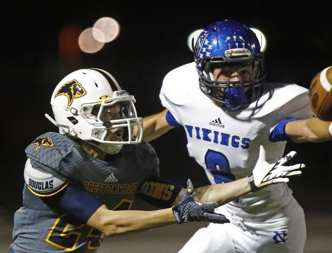 Prestonwood receiver Blake Frasier (24) was unable to make this catch in the first quarter against Nolan defensive back Damon Ramirez (8) as Prestonwood Christian Academy hosted Fort Worth Nolan Catholic High School on Oct. 24.