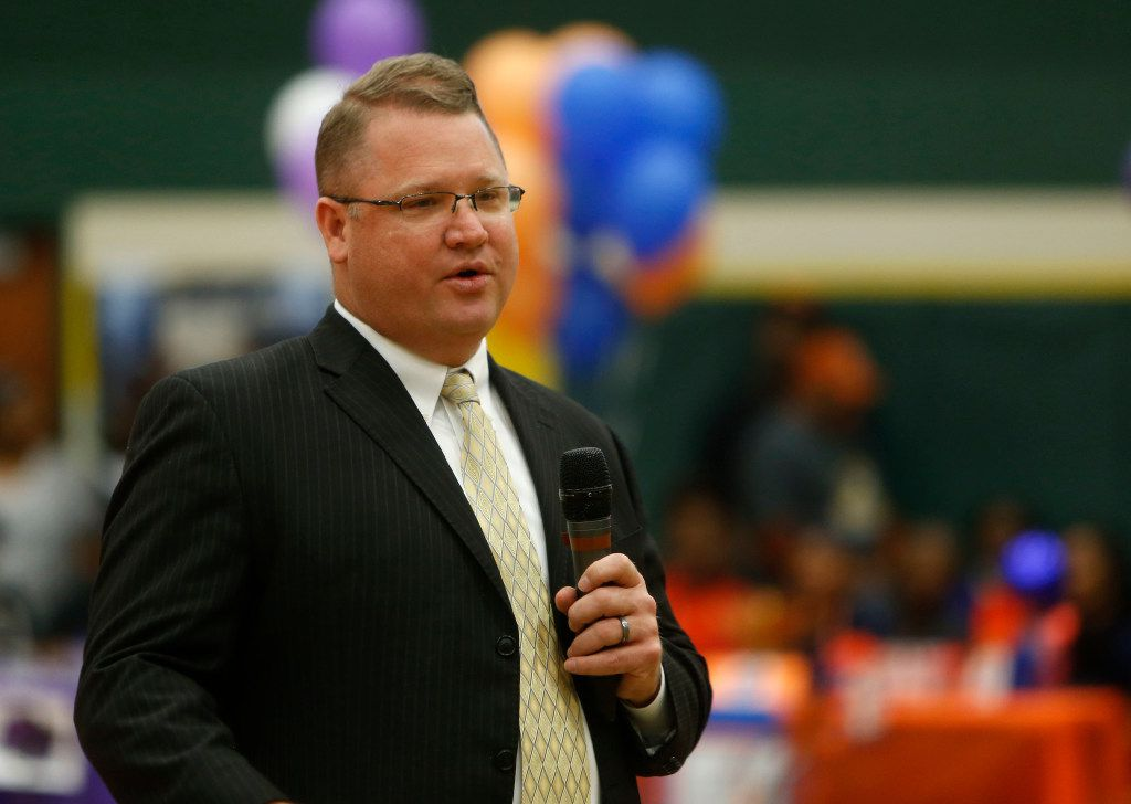 Todd Peterman speaks during a national signing day ceremony at DeSoto on Feb. 1, 2017. (Rose Baca/The Dallas Morning News)