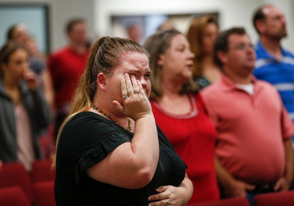 """Church goers gather at Mission Dorado Baptist Church on Sunday, Sept. 1, 2019. The church sits within sight of the movie theatre where police took down a gunman who killed at least seven people and shot more than 20 people Saturday. """"This is Odessa, Texas. Things like this don't happen here,"""" said Pastor Del Traffanstedt. (Ryan Michalesko/The Dallas Morning News)"""