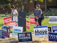 Voters lined up to cast their ballots during early voting at Fretz Park Public Library in Dallas on Oct. 20, 2020.