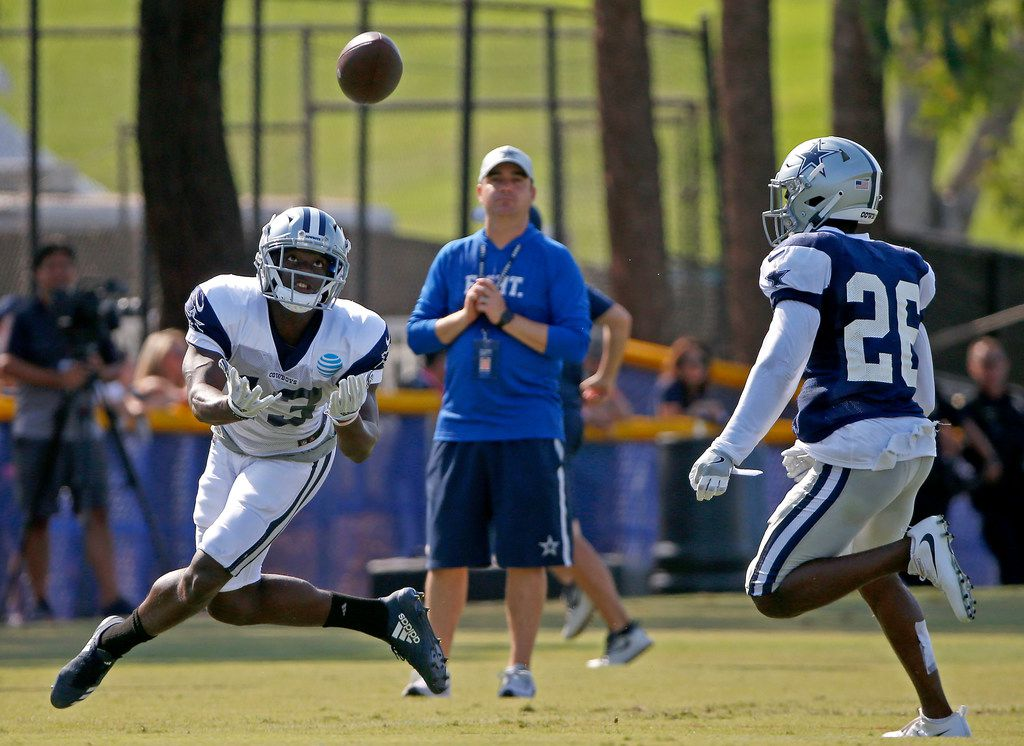 Dallas Cowboys wide receiver Michael Gallup (13) watches the pass over cornerback Duke Thomas during practice at the training camp in Oxnard, Calif., Sunday, July 29, 2018. (Jae S. Lee/The Dallas Morning News)