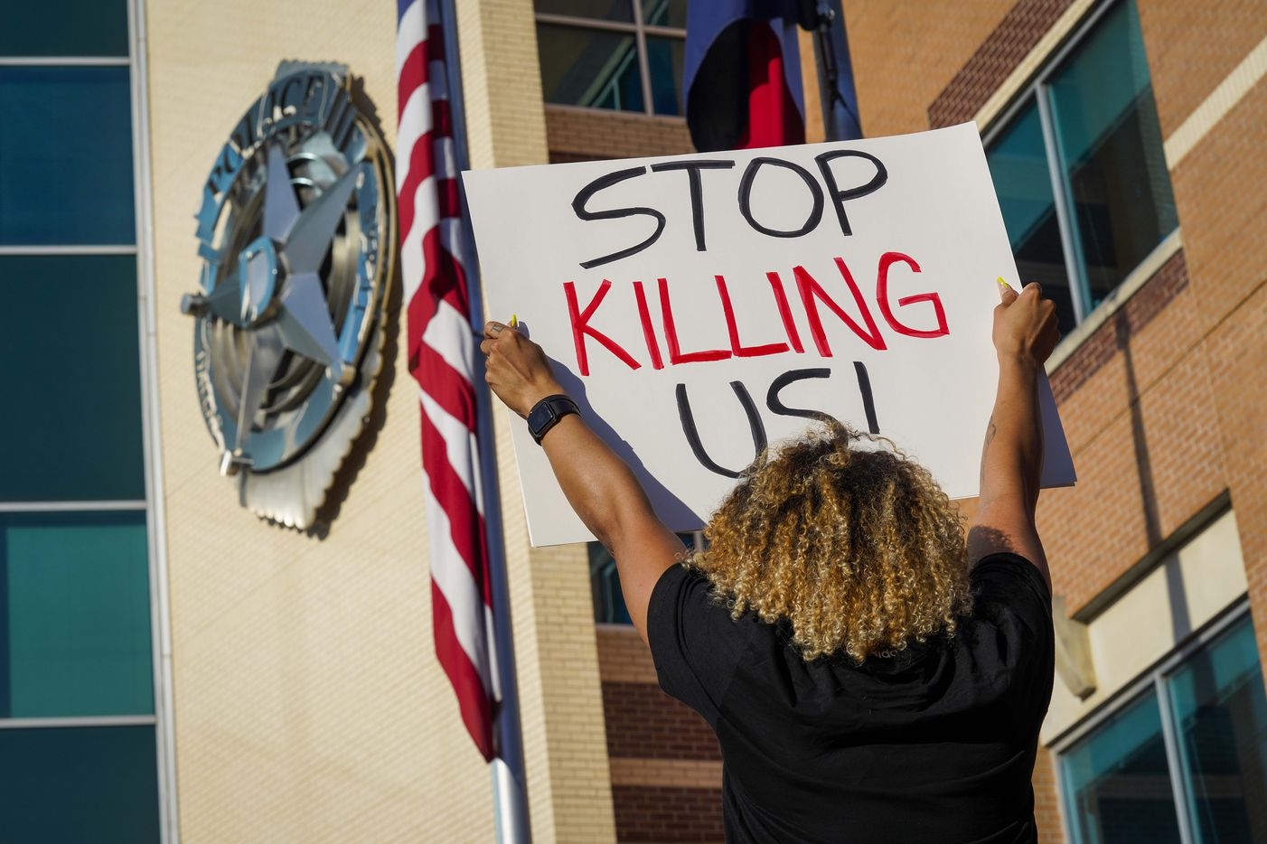 Demonstrators protest against police brutality at the Dallas Police Headquarters on Friday, May 29, 2020, in Dallas.