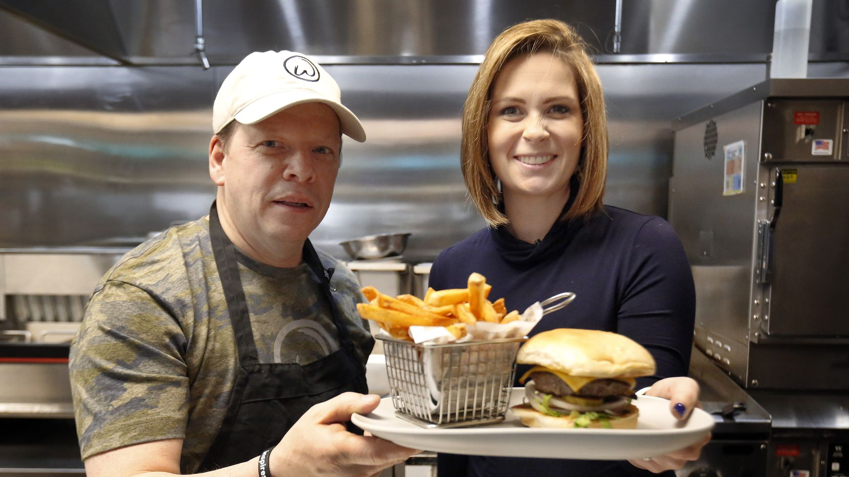 Wahlburgers co-founder Paul Wahlberg showed Dallas Morning News restaurant reporter Sarah Blaskovich how to cook their famous burgers at the Frisco restaurant. Paul is brothers and co-founders in the business with Donnie Wahlberg of New Kids on the Block and actor Mark Wahlberg.