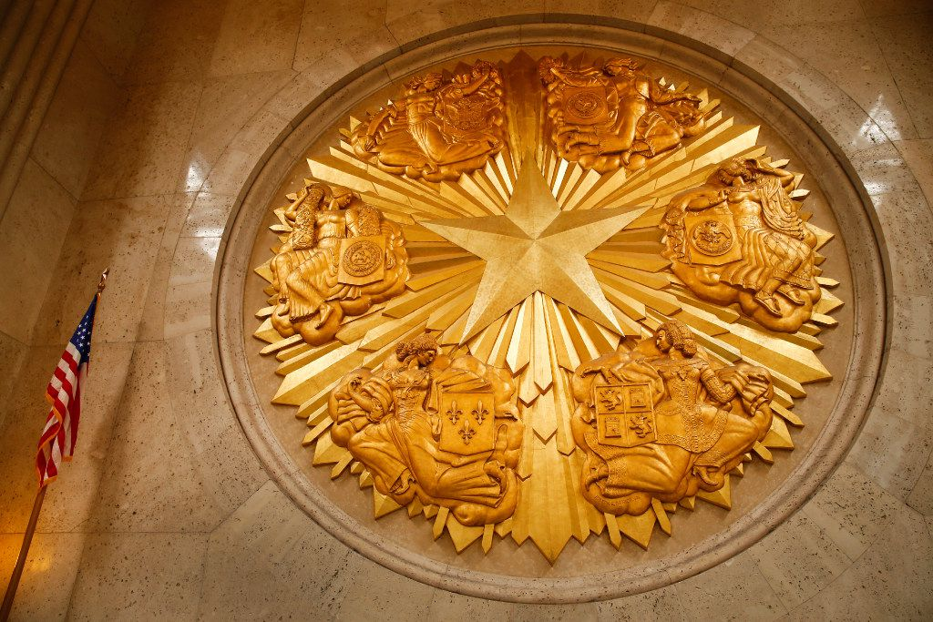 Fair Park's Hall of State gold-leafed medallion represents  the six flags of Texas, including the Confederacy.