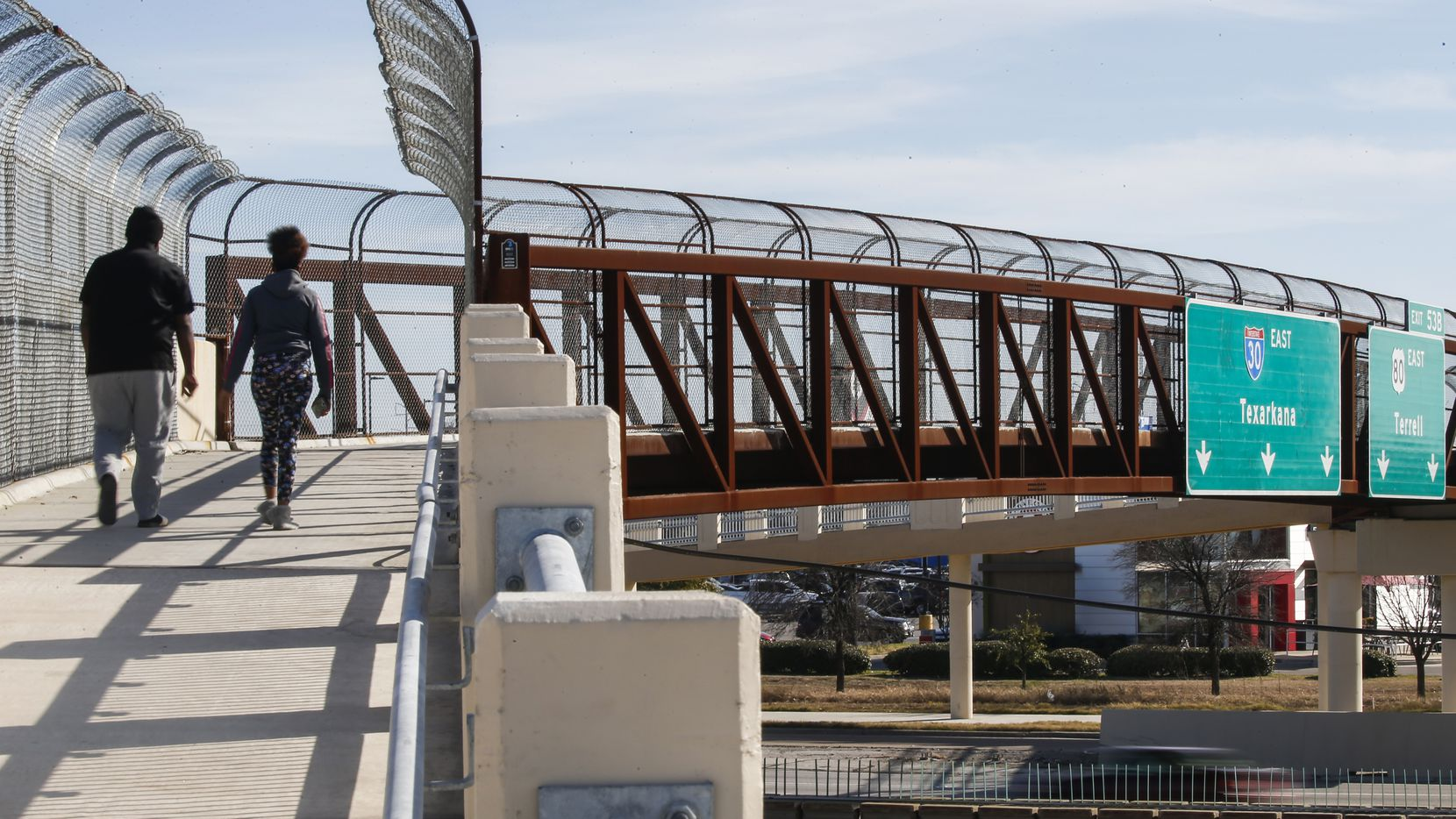 Pedestrians use the walking bridge over Interstate 30. The nearby St. Francis Avenue bridge has no dedicated walking lanes. The Texas Department of Transportation says the pedestrian bridge was built as a safer way to cross the interstate.