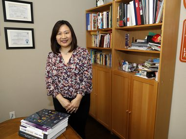 Shirley Yu, at her home in Sachse, studied to learn new skills, pass exams and earn five technology certificates after being laid off last summer. For months, she couldn't get an interview, but sentiment seemed to change in late March. On Tuesday, she starts a new job as a project manager for AT&T.