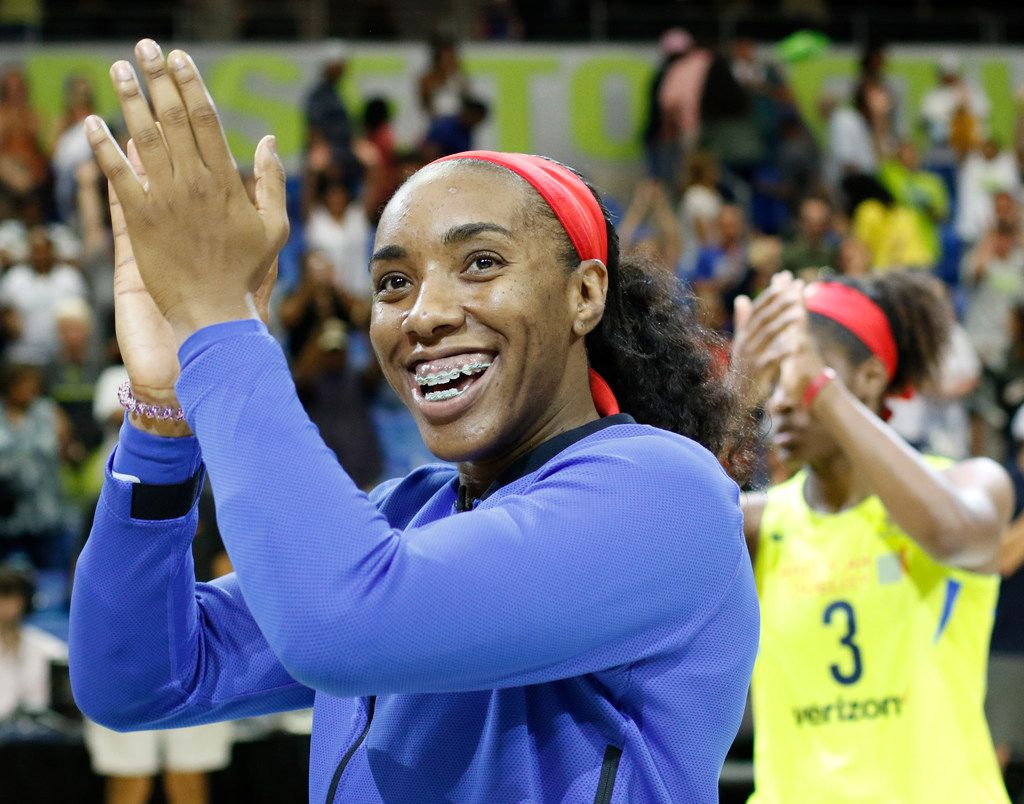 Dallas Wings forward Kayla Thornton was all smiles as she celebrates with teammates following their 101-72 victory over the LA Sparks. The two teams played their WNBA game at UT-Arlington's College Park Center in Arlington on June 22, 2018. (Steve Hamm/ Special Contributor)