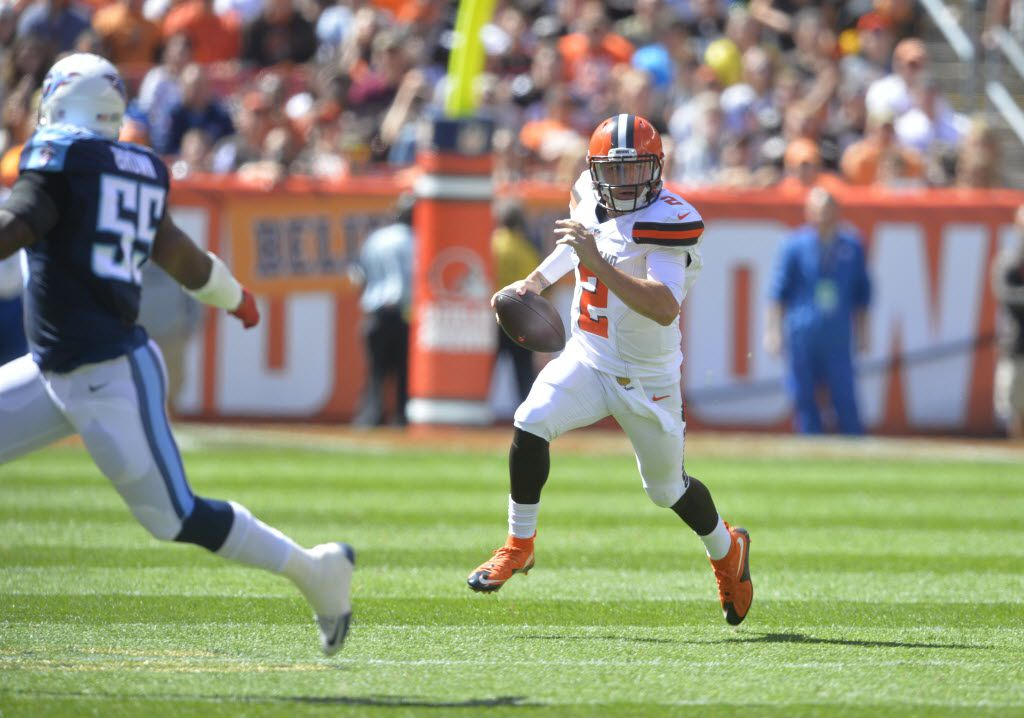 Cleveland Browns quarterback Johnny Manziel scrambles during the first half of an NFL football game against the Tennessee Titans, Sunday, Sept. 20, 2015, in Cleveland. The Browns won 28-14. (AP Photo/David Richard)