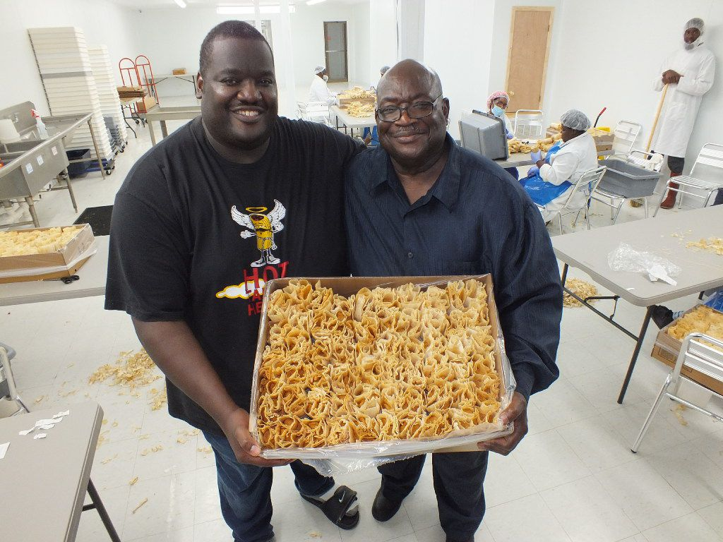 Aaron Harmon (left) and his father, Willie, run Hot Tamale Heaven, a restaurant and manufacturing facility in Greenville, Mississippi. They make about 20,000 tamales each day.
