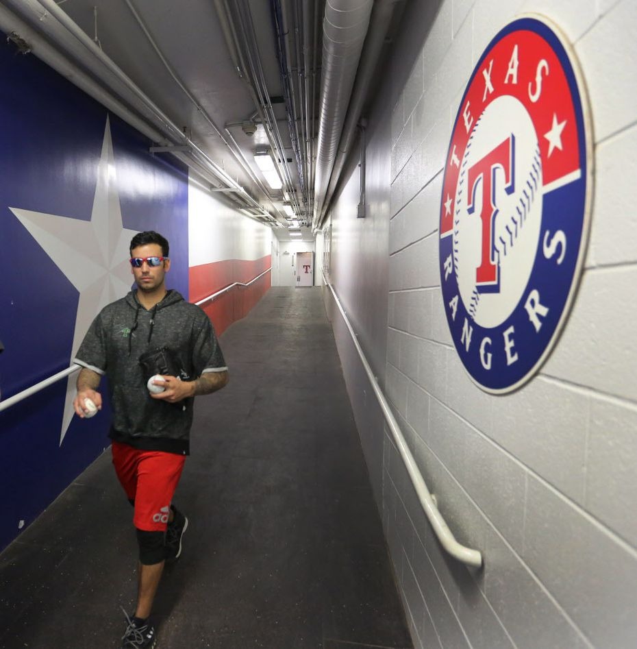 Texas Rangers relief pitcher Matt Bush, right, walks down the tunnel to the field at Globe Life Park in Arlington, photographed on Thursday, January 26, 2017. (Louis DeLuca/The Dallas Morning News)