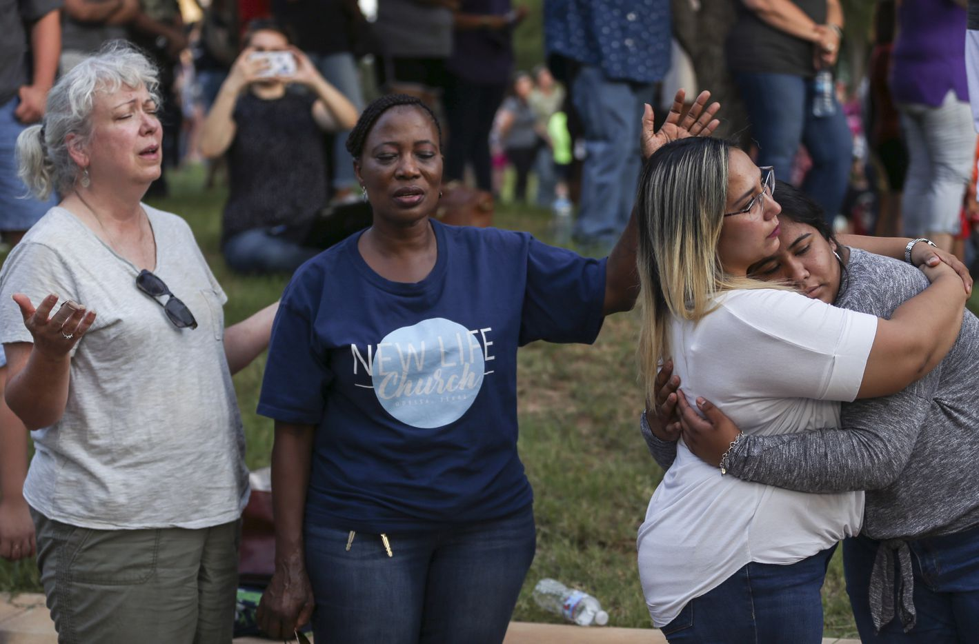 Community members gather for a prayer vigil at the University of Texas Permian Basin on Sunday, Sept. 1, 2019.