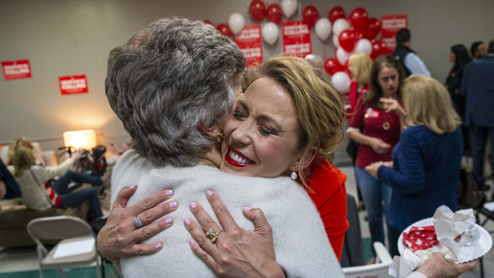 District 32 congressional candidate Genevieve Collins (right) greets Trinka Taylor during an election watch party at Collins' campaign headquarters in Dallas on March 3, 2020.