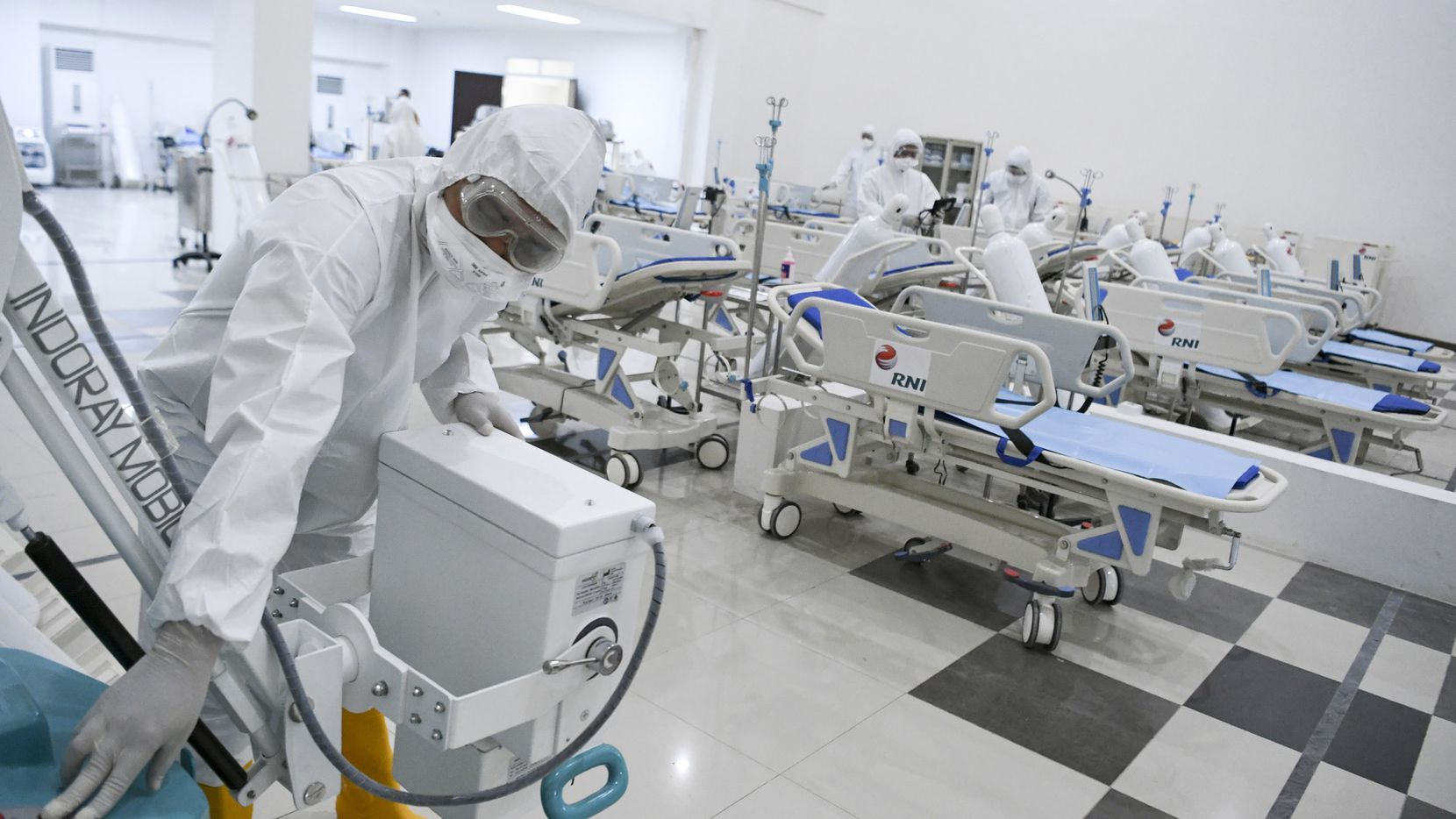 Staff inspect medical equipments at an emergency hospital set up amid the new coronavirus outbreak in Jakarta, Indonesia, on Monday.