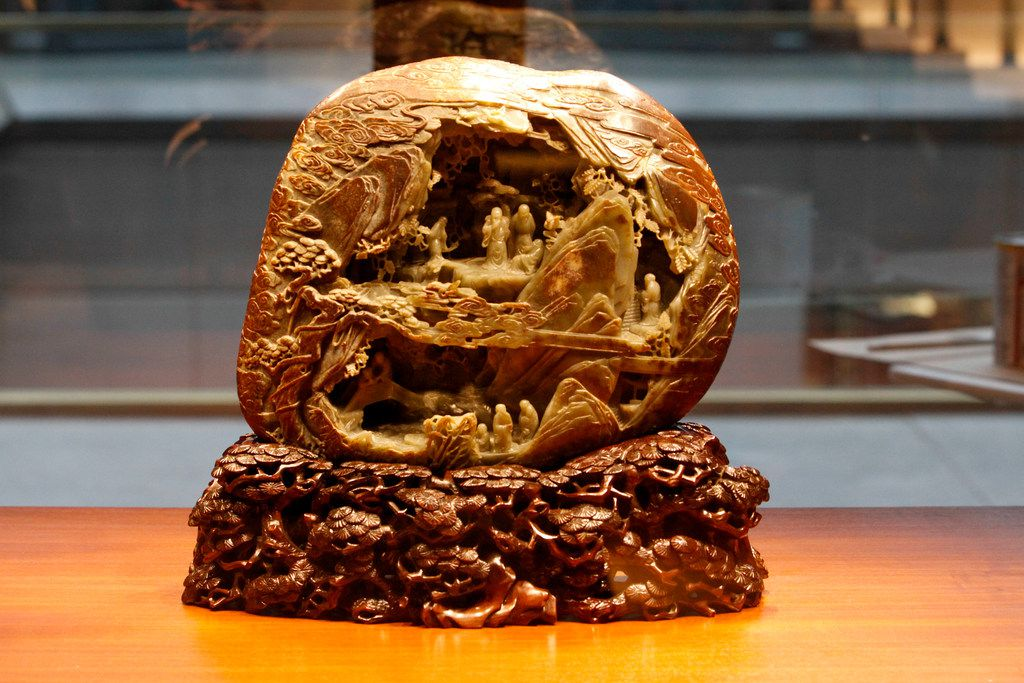 """A carving titled """"Adobe of the immortals"""" from the Qing Dynasty (1644-1911) on display in the Jade room as part of the Immortal Landscapes exhibit at the Crow Museum of Asian Art in Dallas on Wednesday, September 26, 2018. (Brian Elledge/The Dallas Morning News)"""