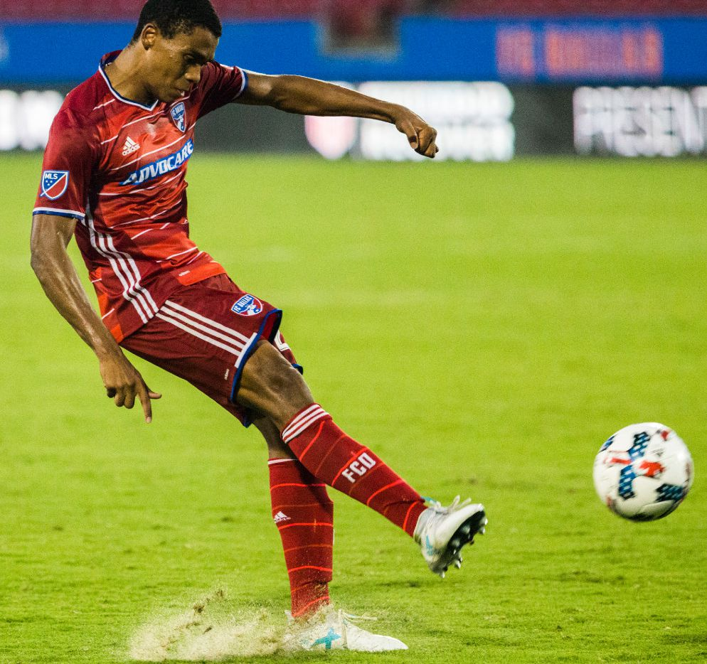 FC Dallas defender Reggie Cannon (22) takes a shot during the second half of an MLS soccer game between FC Dallas and the Colorado Rapids on Tuesday, June 27, 2017 at Toyota Stadium in Frisco, Texas. (Ashley Landis/The Dallas Morning News)
