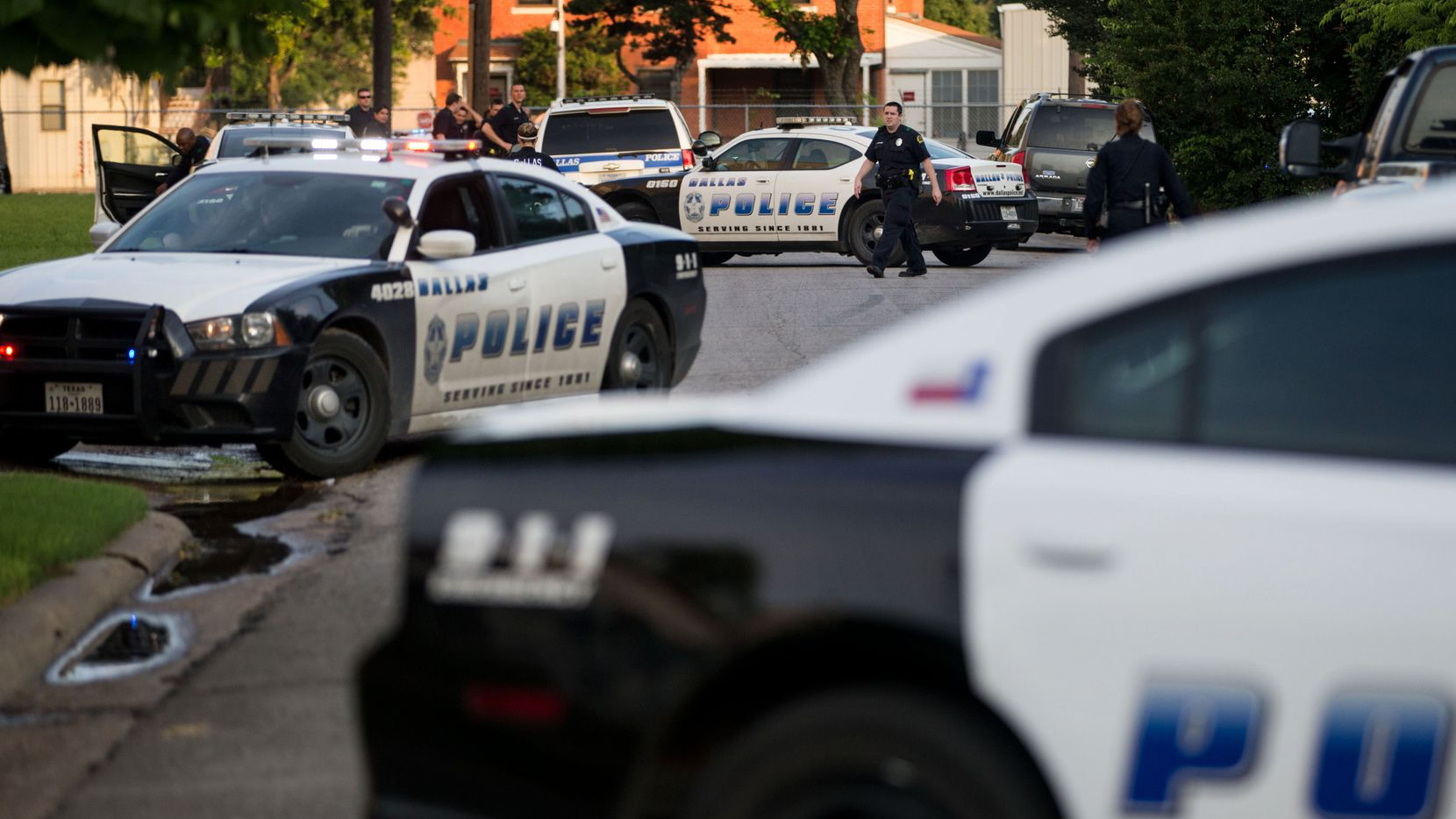 Police officers respond to a shooting near the VA Medical Center in Dallas.