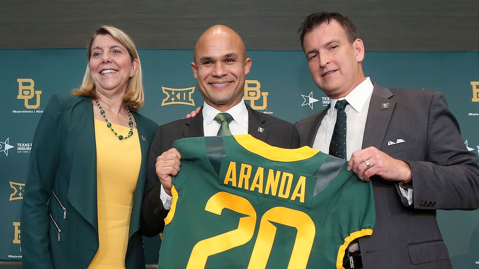 FILE - Baylor president Dr. Linda A. Livingstone, left, and athletic director Mack Rhoades, right, present new head football coach Dave Aranda, center, with a jersey during a news conference on Monday, Jan. 20, 2020, in Waco.