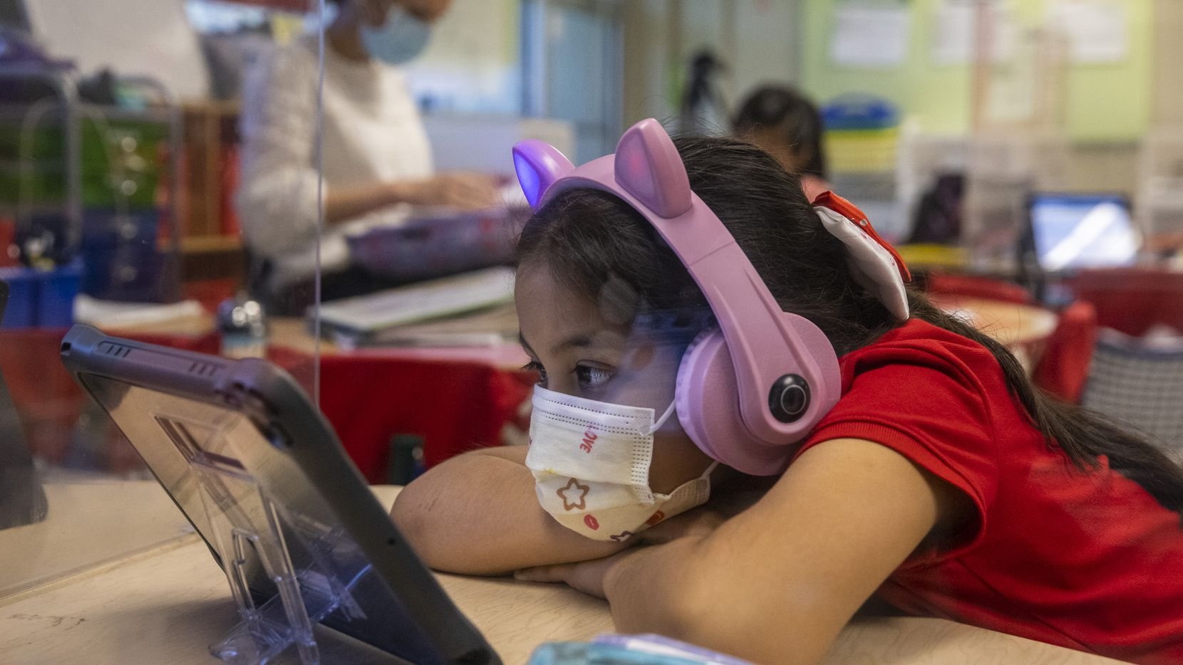 Kindergarten student Ariadne Aguinaga works independently at F.P. Caillet Elementary in Dallas on Wednesday, May 5, 2021. (Lynda M. González/The Dallas Morning News)