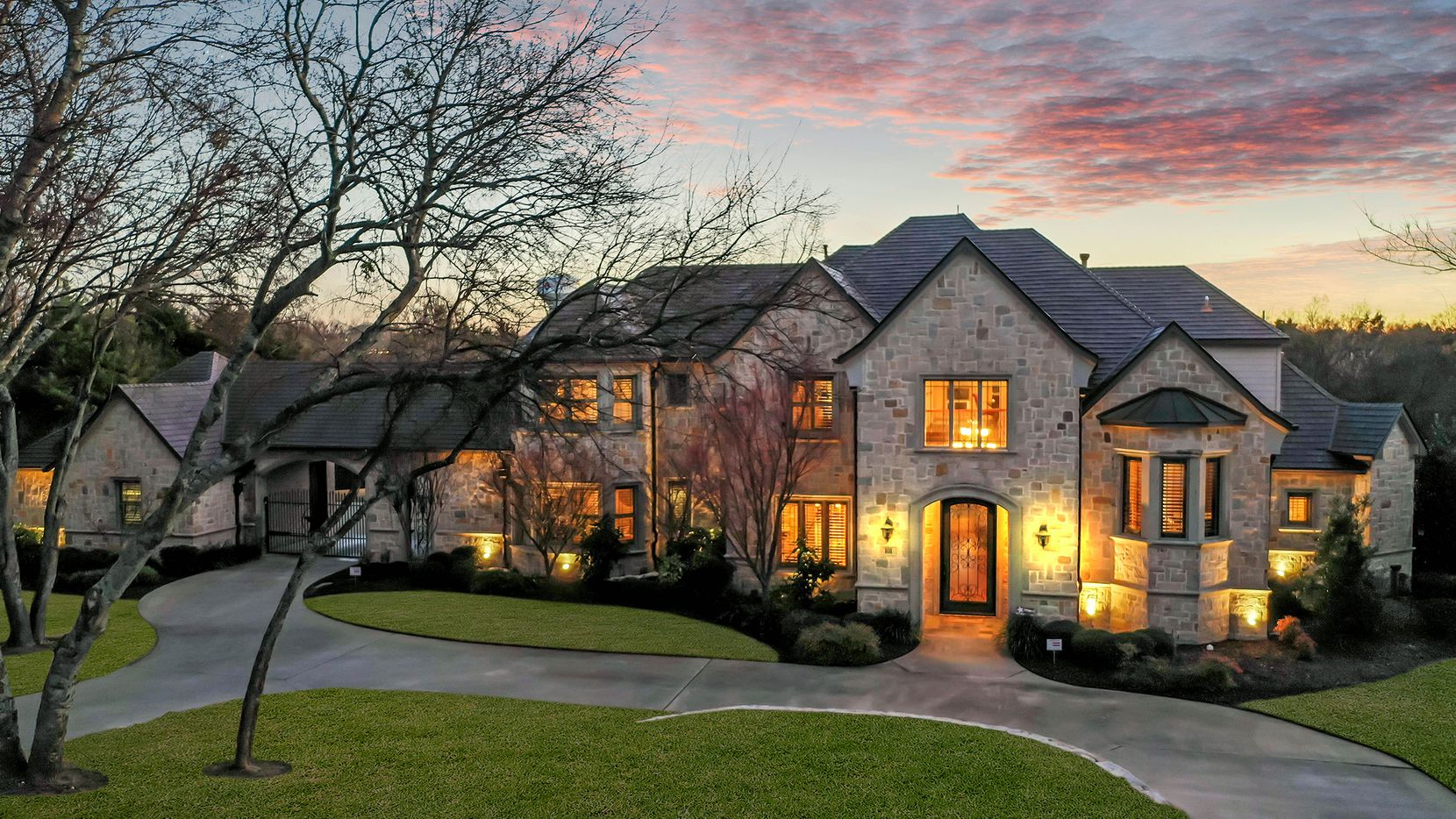 The French Provincial home situated on 1.46 acres at 101 Blue Heron in Heath is adjacent to a protected 10-acre bird sanctuary and overlooks Lake Ray Hubbard.